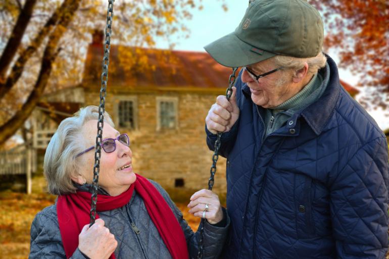 Elderly Couple Smiles with Dental Implants